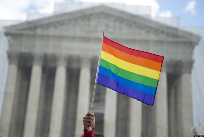 A same-sex marriage supporter waves a rainbow flag in front of the US Supreme Court on March 26, 2013 in Washington, DC, as the Court takes up the issue of gay marriage. The US Supreme Court on Tuesday heard arguments on the emotionally charged issue of gay marriage as it considers arguments that it should make history and extend equal rights to same-sex couples. Waving US and rainbow flags, hundreds of gay marriage supporters braved the cold to rally outside the court along with a smaller group of opponents, some pushing strollers. Some slept outside in hopes of witnessing the historic hearing. AFP PHOTO / Saul LOEB (Photo credit should read SAUL LOEB/AFP/Getty Images)